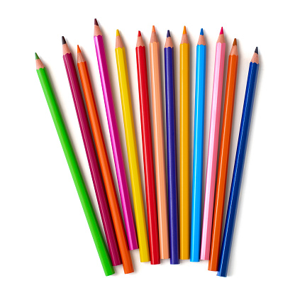 Close up of color pencils with different color isolated on white background. Top view.