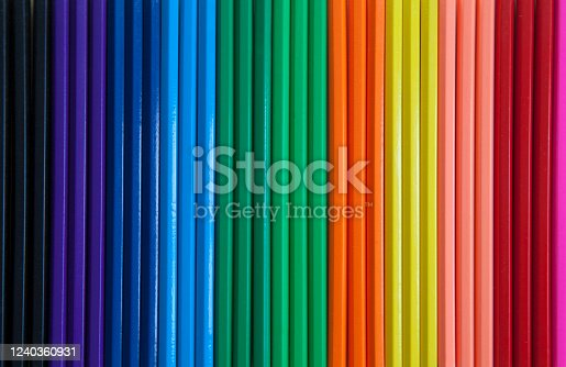 A close up of colored pencils lined up in a row
