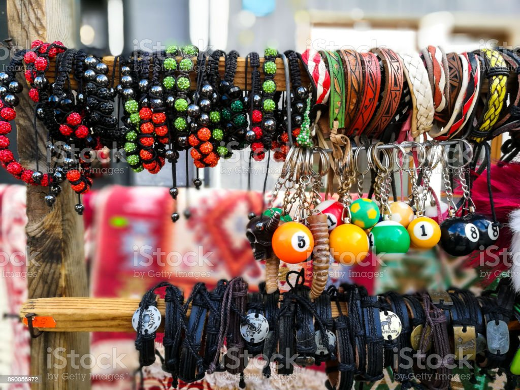 Close up of colorful and leather bracelets in a row on market stall stock photo