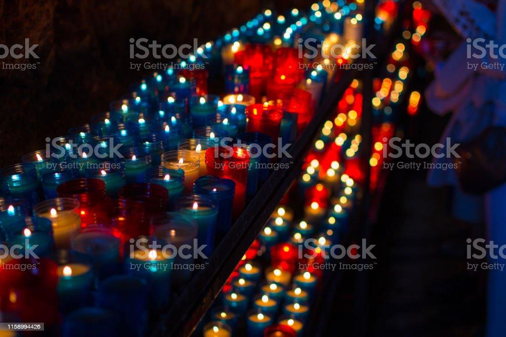 Close up of colorful candles in a dark spiritual scene....