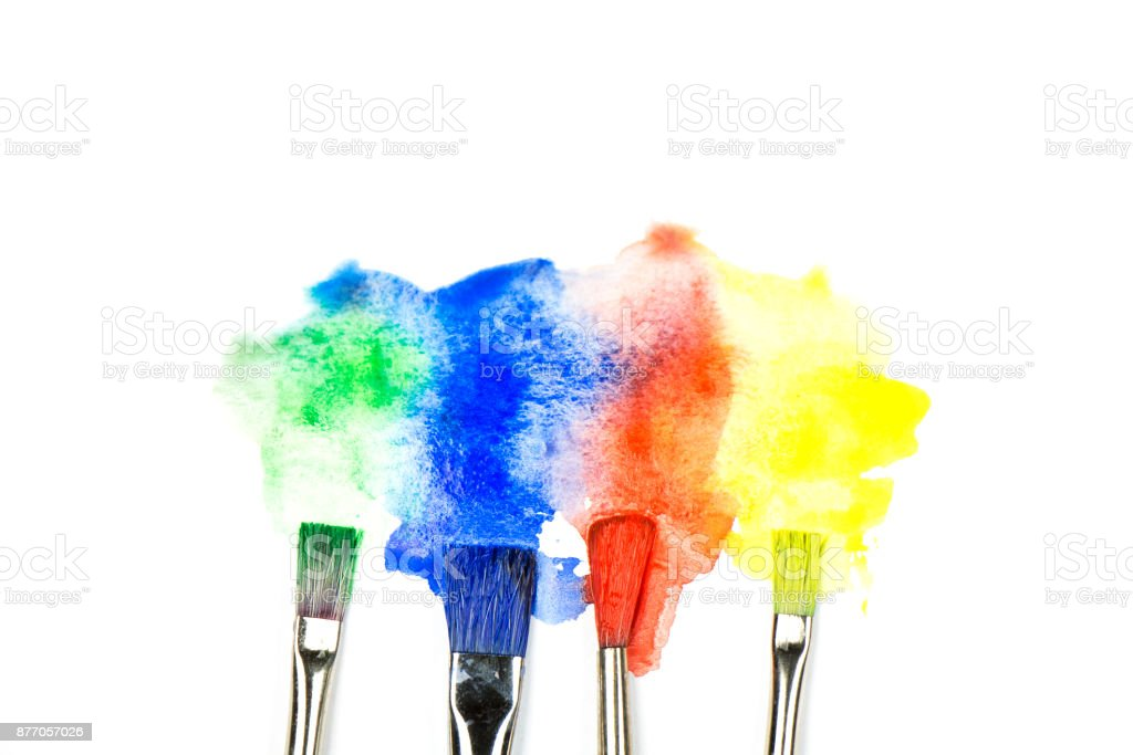 Close up of colorful watercolor stains with paintbrushes on white background stock photo