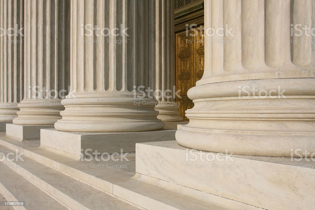 Close up of columns at the supreme court stock photo