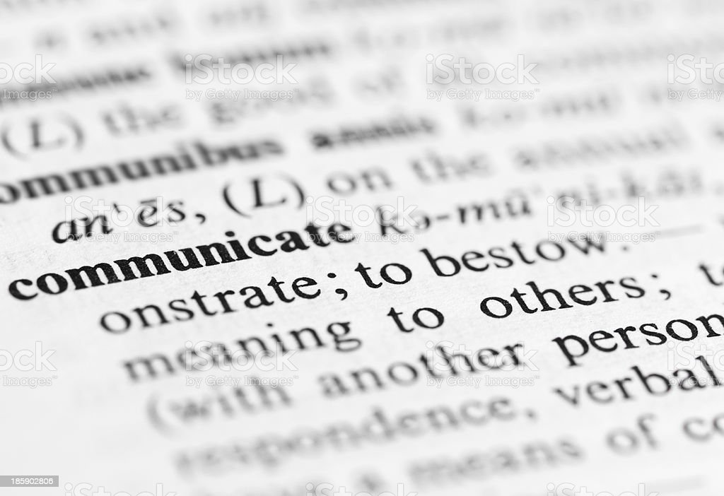 Close up of communicate definition royalty-free stock photo