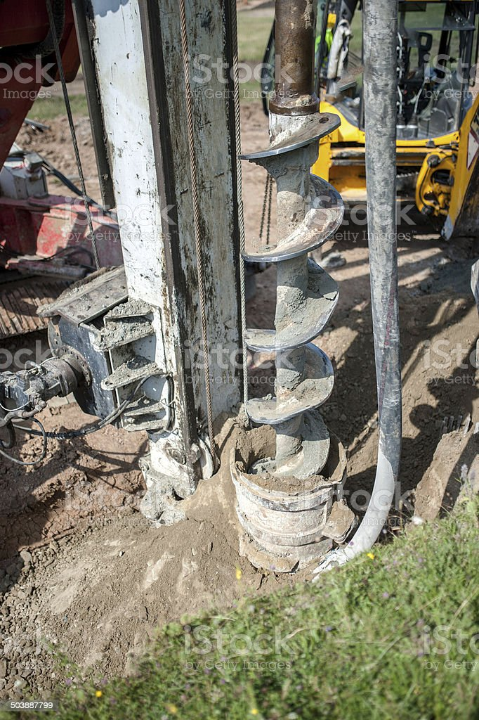 Close up of construction auger, industrial drilling rig stock photo