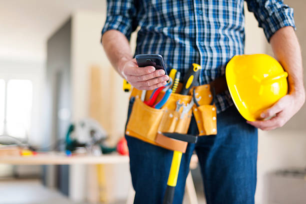 close up of construction worker with mobile phone - tool belt stock photos and pictures
