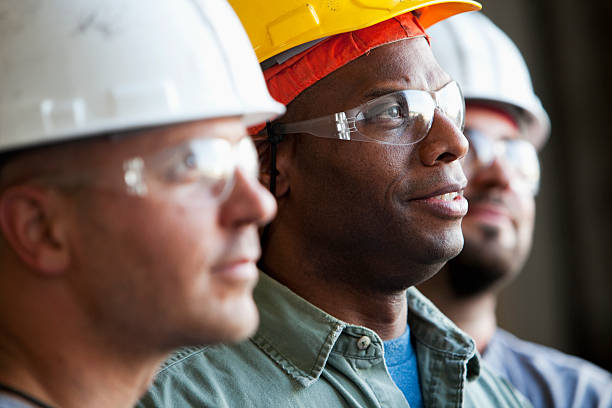 close up of construction workers - manufacturing occupation stock photos and pictures