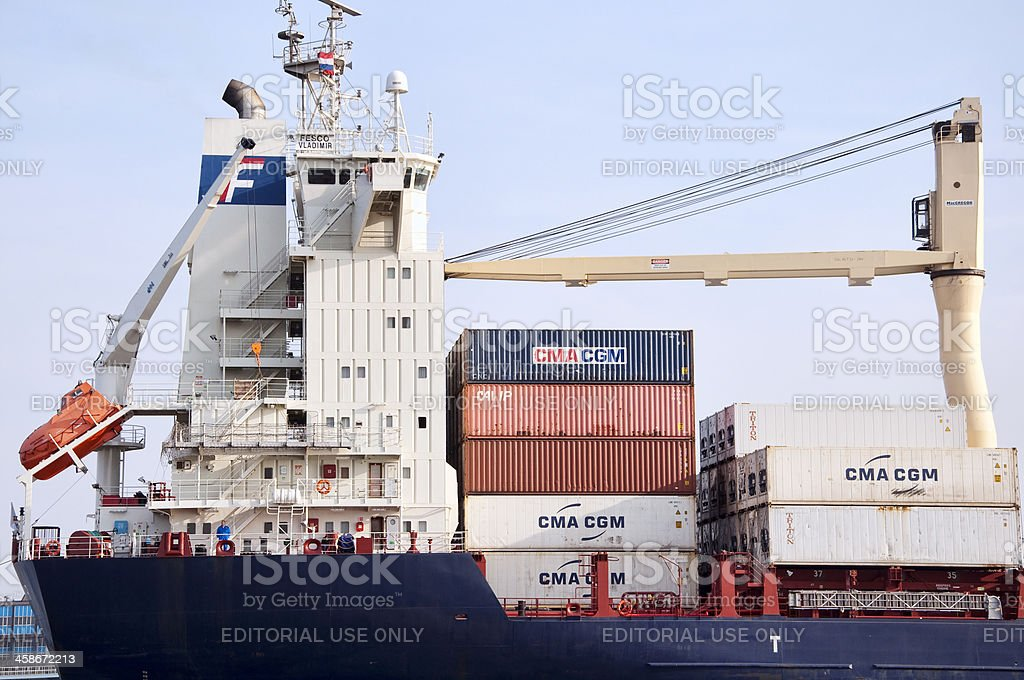 Close up of container ship docked in Rotterdam Harbor royalty-free stock photo
