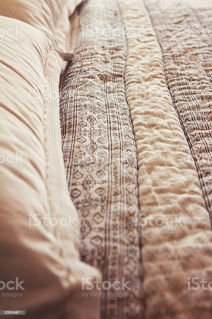 Close up of contemporary luxury bed quilt cover and pillows stock photo