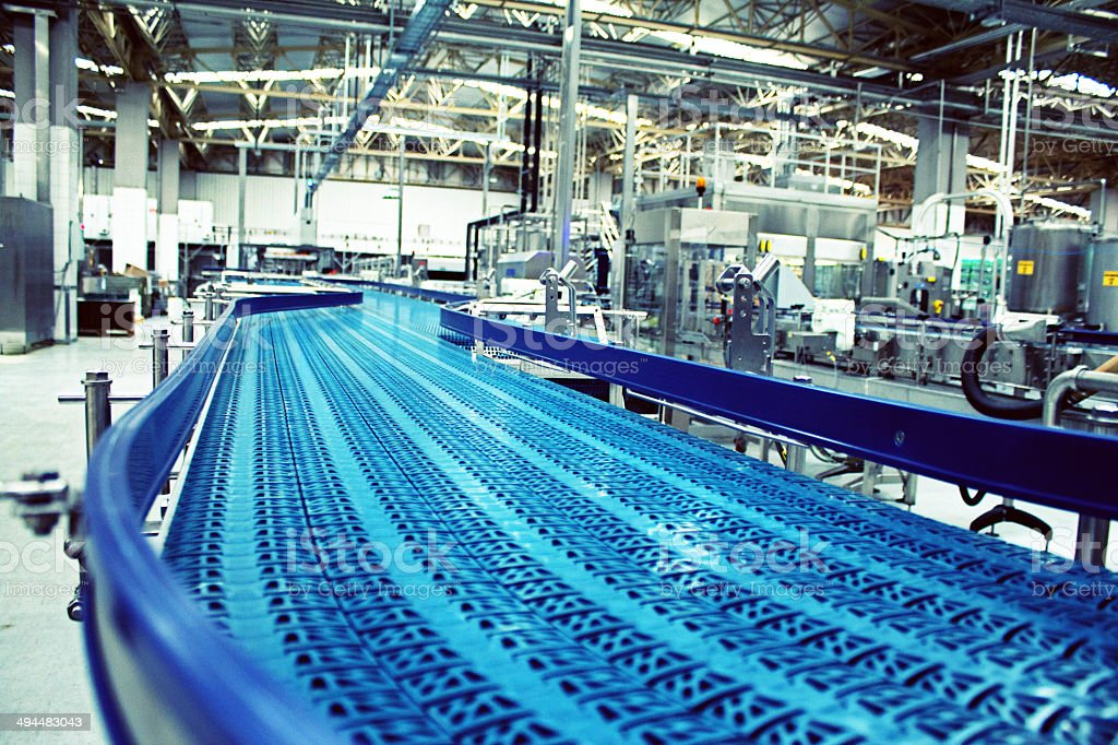 Close up of conveyor belt in bottling plant stock photo