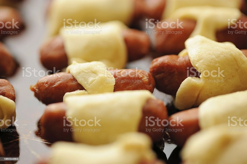 Close up of cooked sausage rolls royalty-free stock photo