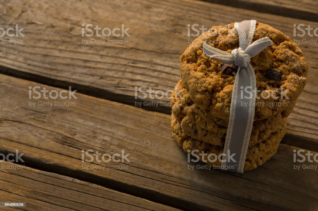 Close up of cookies tied with ribbon on wooden table stock photo