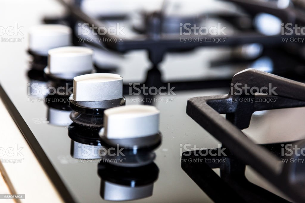 Close up of cooking hob in kitchen interior stock photo