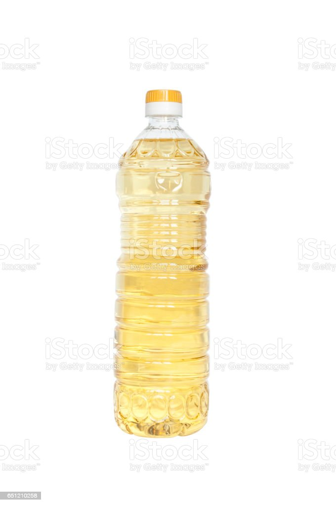 Close up of cooking oil bottle on white background stock photo