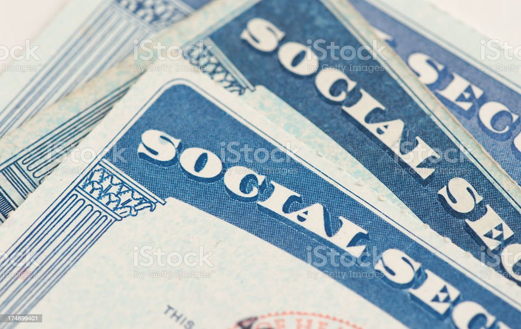 Close up of corner of several social security cards stock photo