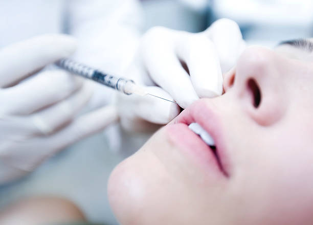 Close Up of Cosmetic botox Injection stock photo
