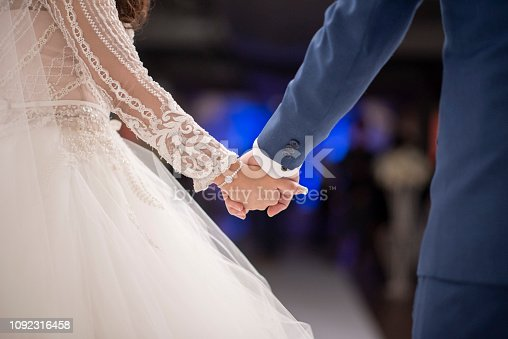Close up of couples hands in wedding ceremony