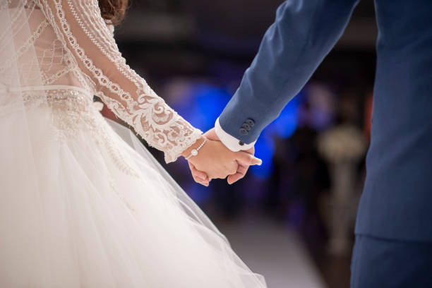 Close up of couples hands in wedding ceremony Close up of couples hands in wedding ceremony bridegroom stock pictures, royalty-free photos & images