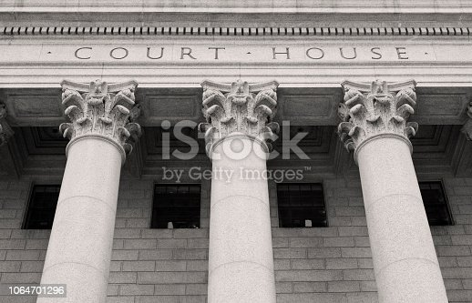 Close up of Courthouse building with pillars and columns .