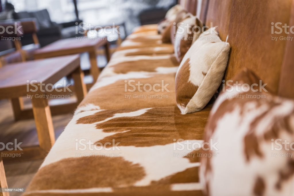 Enjoyable Close Up Of Cowhide Leather Sofa In Brown Stock Photo Bralicious Painted Fabric Chair Ideas Braliciousco