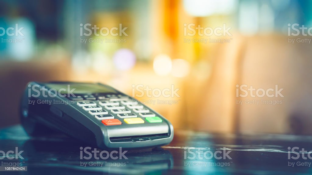 Close up of credit card machine Close up of credit card machine with blurred background Backgrounds Stock Photo