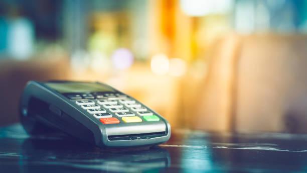 Close up of credit card machine stock photo