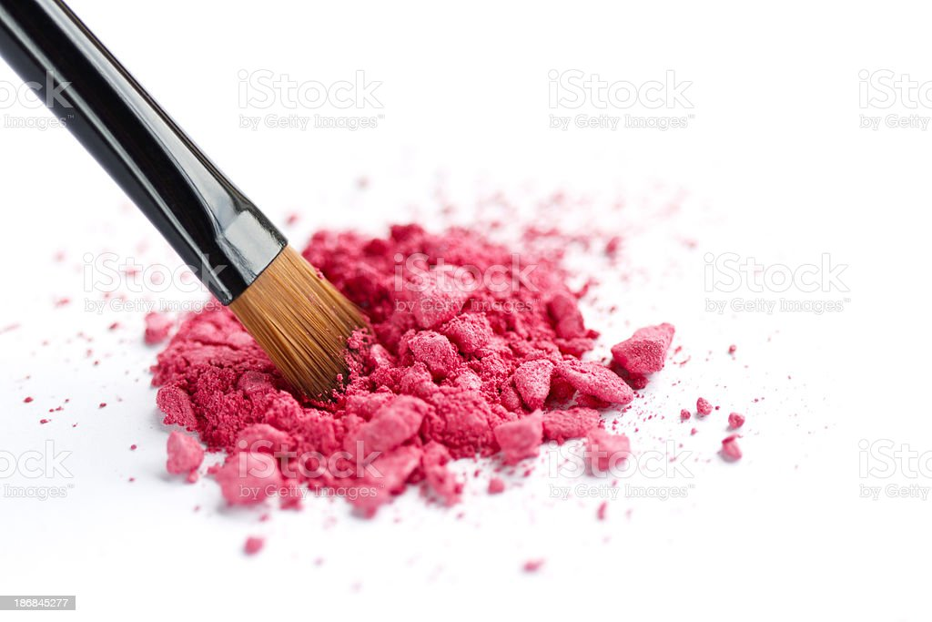 Close up of crushed cosmetic and brush royalty-free stock photo