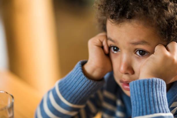 Cтоковое фото Close up of crying little black boy.