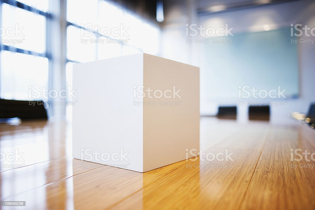 Close up of cube on conference room table stock photo