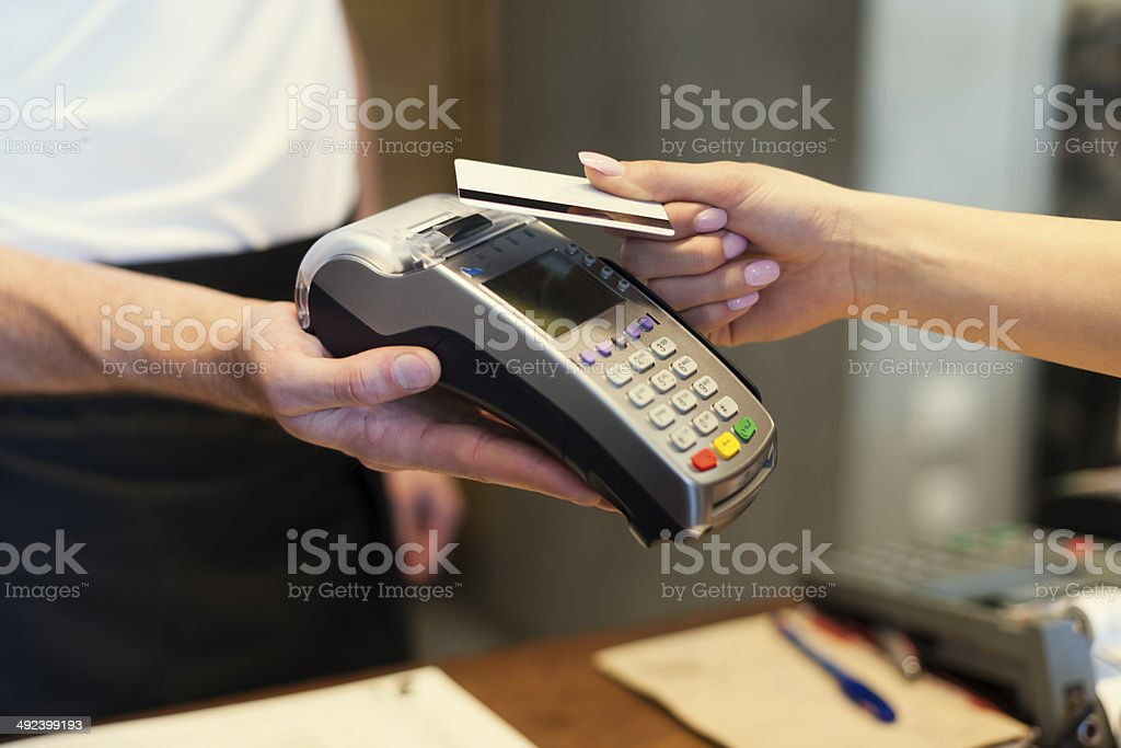 Close up of customer paying by credit card stock photo