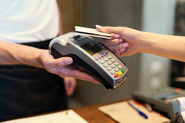close up of customer paying by credit card - contactless payment stock pictures, royalty-free photos & images