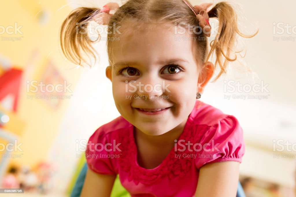 Groovy Close Up Of Cute Little Girl With Ponytails Stock Photo Download Natural Hairstyles Runnerswayorg