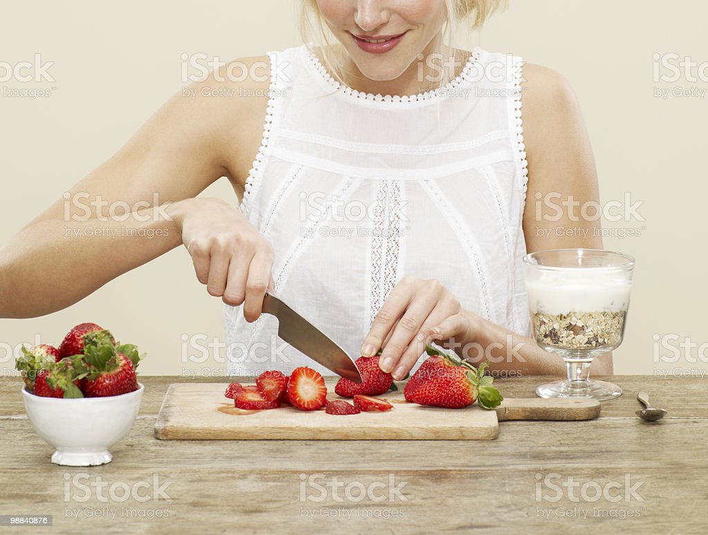 close up of cutting strawberries for breakfast royalty free stockfoto