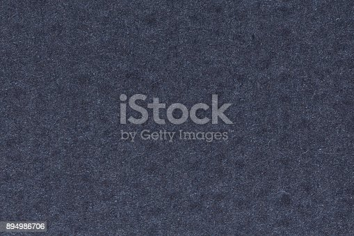 Close up of dark blue textured background. Texture of blue background with gray spots and dots. High resolution photo.