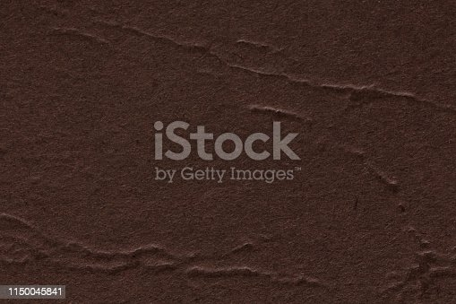 istock Close up of dark brown paper texture background, can be used for arts. 1150045841