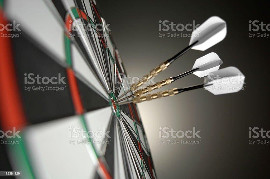 Close Up Of Darts in Bullseye stock photo