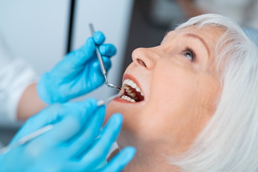 Close up of dentist performing dental examination