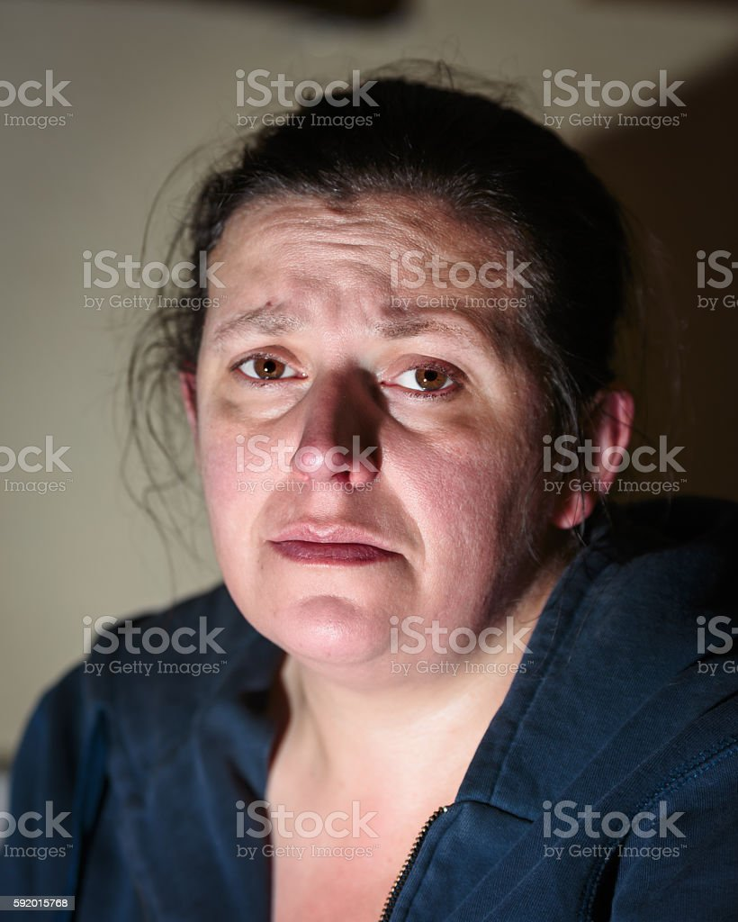 Close up of depressed looking middle aged woman stock photo