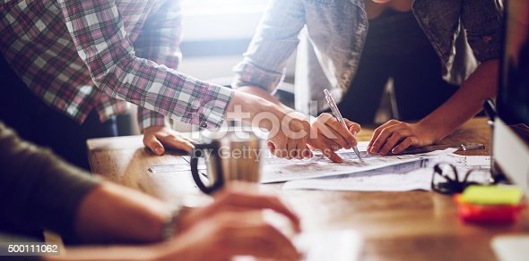 istock Close up of designers hands 500111062