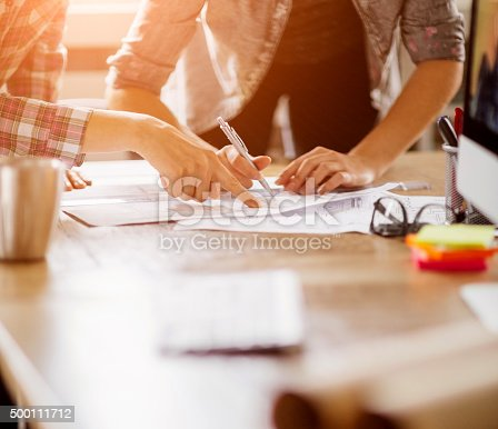 istock Close up of designers hands 500111712