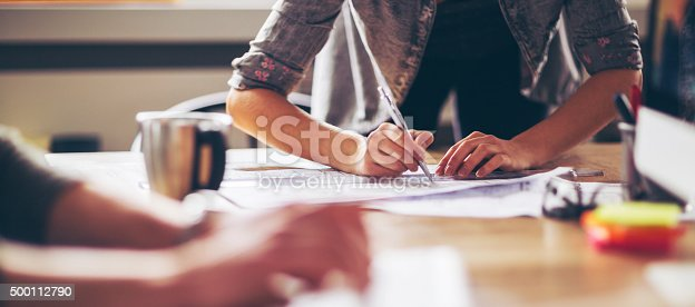 istock Close up of designers hands 500112790