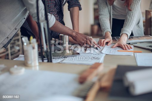 istock Close up of designers hands 500881162