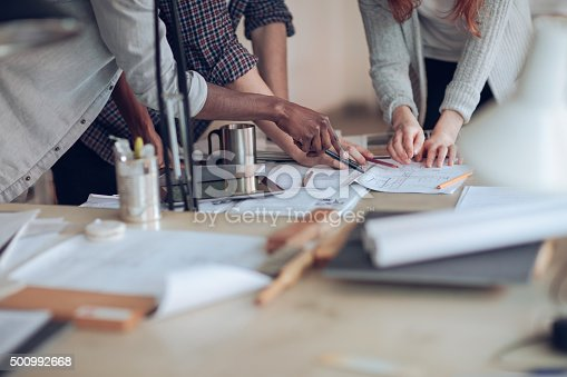 istock Close up of designers hands 500992668