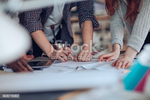 istock Close up of designers hands 503215052