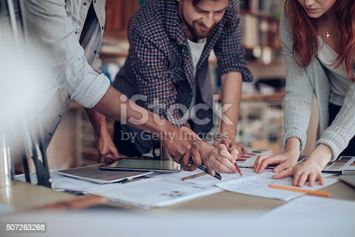 istock Close up of designers hands 507263268