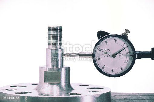 istock Close up of Dial gauge measure the part after production process to check the precision and accuracy corresponding to spec 974449158