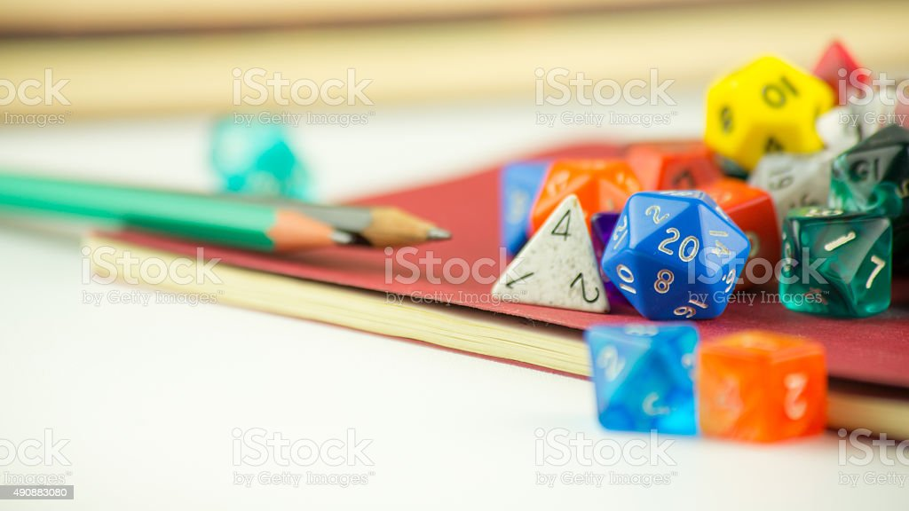 Close up of dice with Pencils on a Notebook stock photo