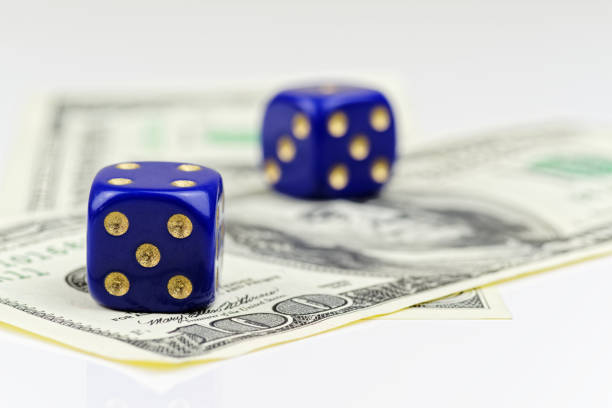 Close up of dices and American dollars on white background stock photo