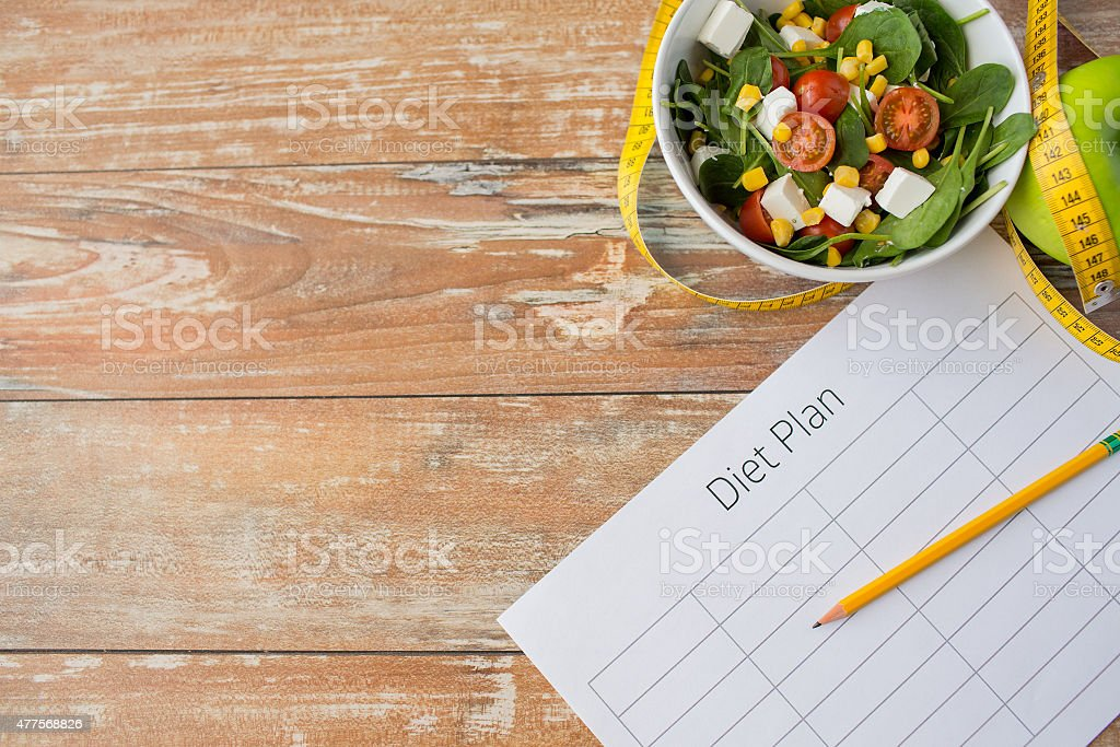 close up of diet plan and food on table royalty-free stock photo