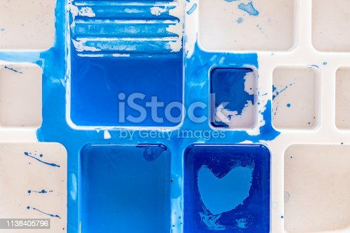 istock Close up of different color oil paint, Patterns or backgrounds of various colors, colors on the fabric. 1138405796