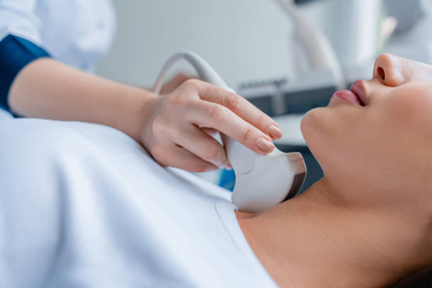 Close up of doctor conducting ultrasound examination of woman in clinic Medicine, Hospital, Medical Clinic, Ultrasound, Doctor scientific imaging technique stock pictures, royalty-free photos & images